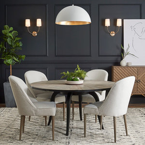 White dome pendant over round table with four chairs