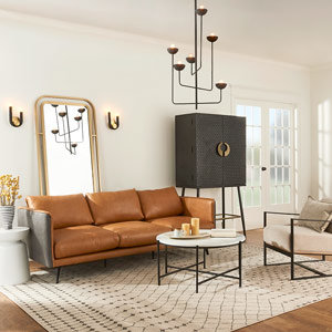Living room with leather couch and large modern chandelier