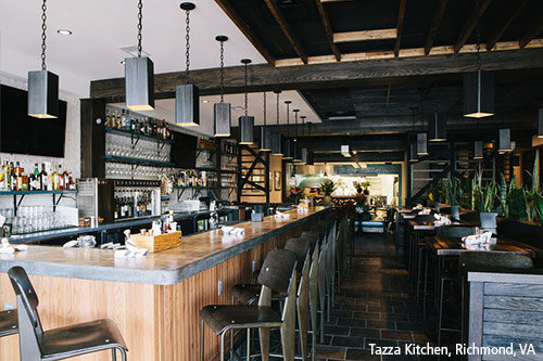 Styled restaurant with pendants over bar in Virginia