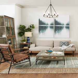 Coastal inspired sitting area with tan couch and layered rugs