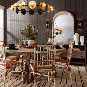 Modern chandelier in rustic dining room with dark walls